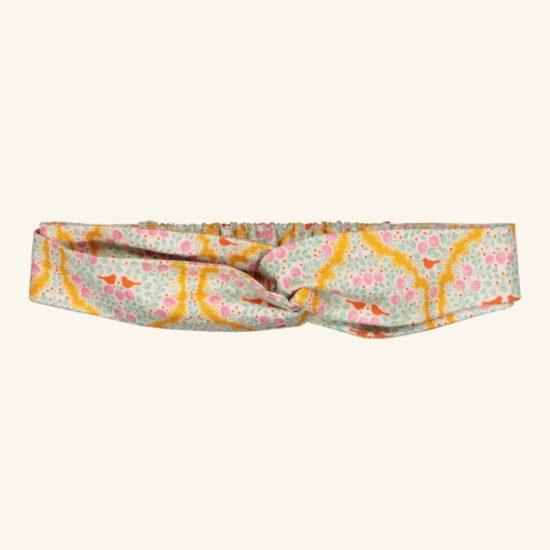 Une joli bandeau qui pourra être assorti à son sac de petite lle ou encore ses petits chaussons. Convient aux petites lles à partir de 12 mois jusqu'à 3 ans.